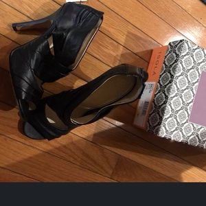 "Black, soft leather shoes, heels; named ""Balta"""